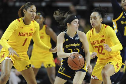 Quinnipiac's Mackenzie Dewees, center, looks to pass between Maryland's Shakira Austin, left, and Blair Watson during the first half of an NCAA college basketball game on Sunday, Nov. 24, 2019, in College Park, Md. (AP Photo/Gail Burton)