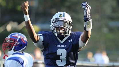 Gilman quarterback Kai Locksley celebrates a long run for a touchdown late in the second quarter during a game against Anacostia in 2013.