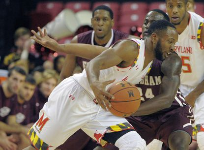 Fordham guard Bryan Smith fouls Maryland guard Dez Wells as he drives into the paint during the first half.