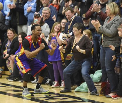 "Harlem Wizards ""King Arthur"" dances with spectators during their show at Westminster High School Tuesday March 13, 2018."