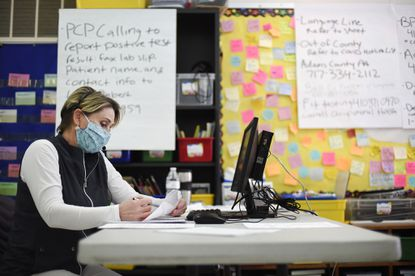 South Carroll school nurse Dawn Reardon takes a call Wednesday, April 22, 2020 while staffing the Carroll County COVID-19 hotline in Westminster. CCPS school nurses are now assigned to work alongside Health Department staff at the County's COVID-19 hotline