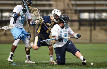 Pallotti goalie Andrew Jumbelick looks back to see the ball safely out of the goal as teammate Francis Oparaocha, left, and Beth Tfiloh's Jacob Welfeld crash the crease during the MIAA C Conference lacrosse championship at Johns Hopkins Homewood Field Friday.