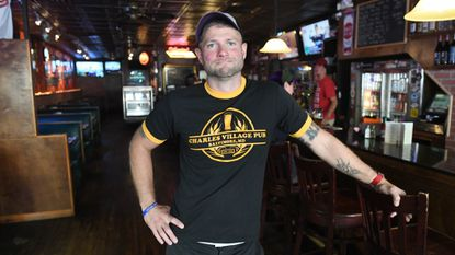 Charles Village Pub owner Tony Wier reopened the bar Thursday after several months of renovations following a kitchen fire.