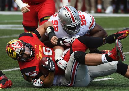 Maryland quarterback C.J. Brown is tackled by Ohio State defensive lineman Adolphus Washington (92) last season. Ohio State, a unanimous No. 1 choice in the Associated Press poll, is one of three preseason top 25 teams on the Terps' schedule.