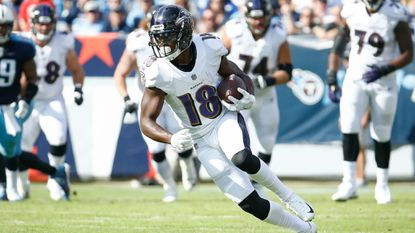 Jeremy Maclin #18 of the Baltimore Ravens runs up field after a reception against the Tennessee Titans at Nissan Stadium in Nashville.