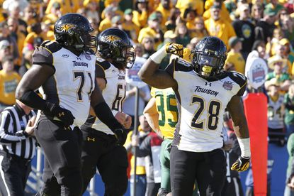 Towson's Terrance West celebrates a touchdown with Sam Evans and Eric Pike (71) in the first quarter against North Dakota State.