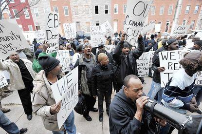 Job seekers gather outside East Baltimore Development Inc. (EBDI) offices.