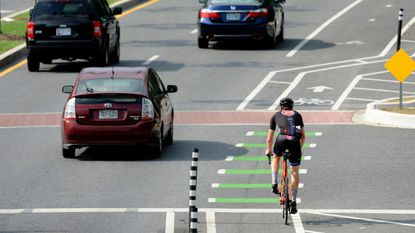 Baltimore, Md -- A cyclist rides in the northbound Roland Avenue bike lane.