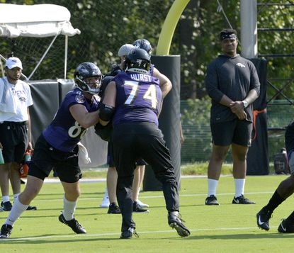Ravens offensive lineman Orlando Brown, Jr., looks on at practice after not passing his conditioning test.