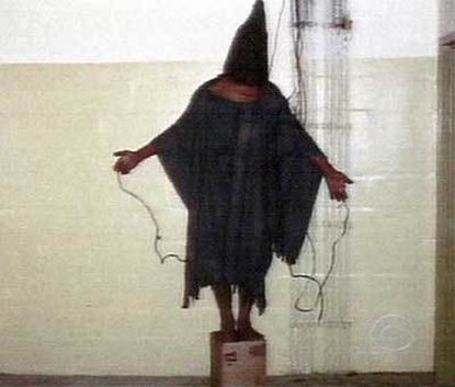 "Hooded prisoner This image from CBS's ""60 Minutes"" shows a hooded Iraqi prisoner standing on top of a box that appears to be connected to wires."
