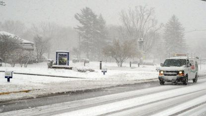 A BGE Home vehicle heads up North Hickory Avenue in Bel Air during an early spring snow storm.