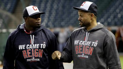 Indians outfielders Raja Davis, left, and Coco Crisp chat during batting practice Thursday in Cleveland.