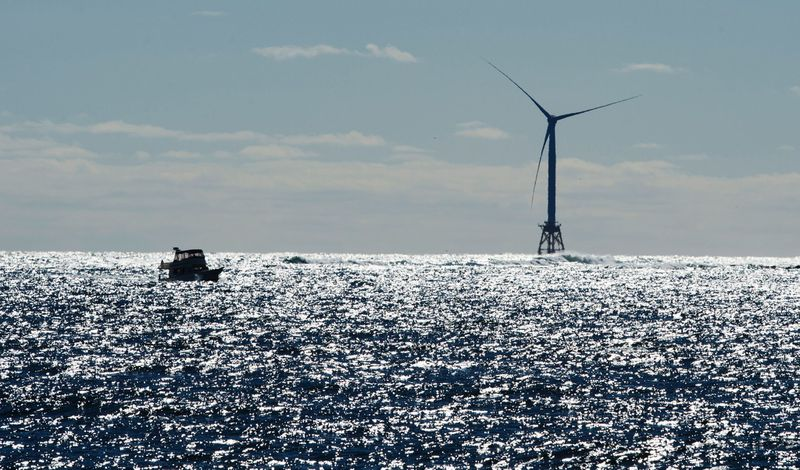 A boat passes one of the wind turbines of the Block Island Wind Farm in 2016 three miles off the shores of Block Island, Rhode Island.