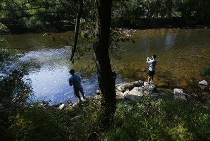 Kyle Beaton, left, and Ryan Weaver, both of Thurmont, angle for bass in the waters of Double Pipe Creek in Detour Tuesday, October 1, 2019. The county plans for Double Pipe Creek watershed are open for public comment Oct. 28 through Nov. 28.