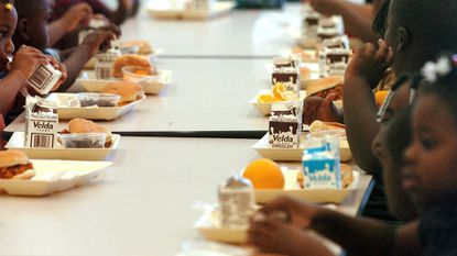Students eat their lunch in the cafeteria of Forest Park Elementary School in Boynton Beach, Fla.