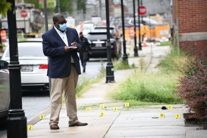 Baltimore City police investigate a homicide scene in the 1100 block of Granby on Monday. August 31, 2020