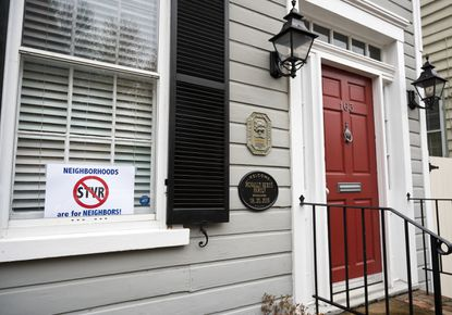 A home on Prince George Street has a sign placed in a window signaling opposition to O-26-19, the short-term vacation rental legislation Annapolis.