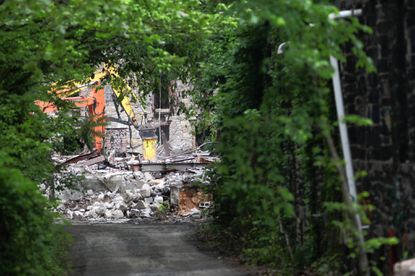 Heavy equipment could be heard but barely seen last week at the site of the vacant Simkins Mill on River Road, a short distance from the Howard County border.