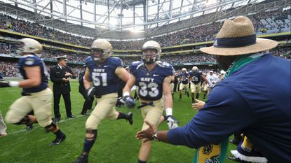 Navy players run on to the field prior to the Notre Dame vs Navy game at Aviva Stadium on Sept. 1, 2012 in Dublin, Ireland.
