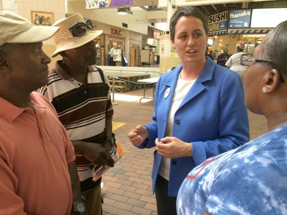 Heather R. Mizeur speaks with Brad Stephens of Randallstown Monday at Lexington Market.