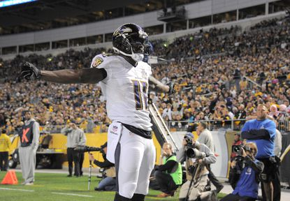 Ravens wide receiver Kamar Aiken celebrates after catching a touchdown pass from Joe Flacco during the third quarter against the Steelers at Heinz Field in Pittsburgh.