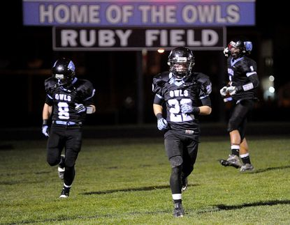 From left, Westminster's Garrett Bean, Jimmy Lauer and Bradley Metcalf run onto the field after halftime during the Owls' game against Blake Nov. 9 in Westminster.