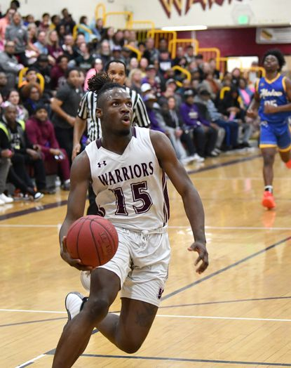 Havre de Grace's Marlon Lewis, shown in a game earlier this year, had three monster dunks and 25 points in the Warriors 51-49 win over Patterson Mill.