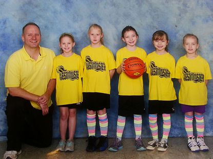 """The Yellow Lightning just completed a season in the Westminster Girls Basketball Association. They finished 0-0 while having a lot of fun and learning a little bit about playing (and coaching) basketball. From left: """"Coach"""" Bob Blubaugh, Maggie Morley, Libby Andrews, Addyson Ruth, McKenna Lanza, and Colleen Blubaugh."""