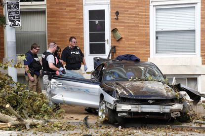 Baltimore police investigate car crash on 3000 block of East Baltimore Street on Tuesday