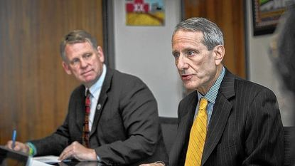 Steve Sachs, of a county economic advisory committee, right, with County Executive Allan Kittleman, at last year's meeting on spending affordability.