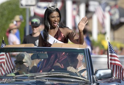 Chiamaka Ezeonyebuchi, Miss Bel Air Independence Day, waves to onlookers during the Bel Air Independence Day parade.