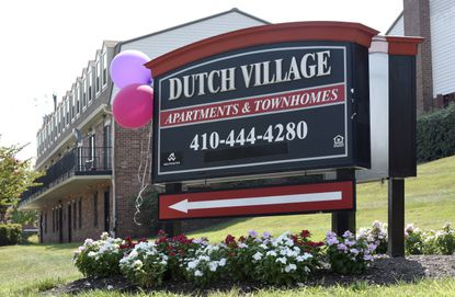 A sign sits outside the Dutch Village apartments and townhomes, owned by the Kushner Cos., in Baltimore. Jared Kushner's family real estate firm owns thousands of apartments and townhomes in the Baltimore area, and some have been criticized for the same kind of disrepair and neglect that the president has accused local leaders of failing to address.
