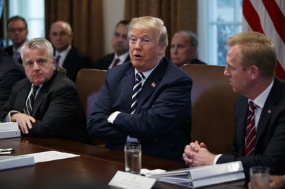 President Donald Trump speaks during a cabinet meeting at the White House on May 9, 2018, in Washington. From left: Deputy Secretary of State John Sullivan, Trump and Deputy Secretary of Defense Patrick Shanahan.