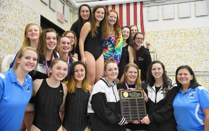 Members of C. Milton Wright's girls swim team and coach Debbie King, far right, celebrate their Harford County championship after Tuesday's county meet at Magnolia Middle School.