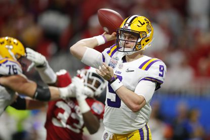 ATLANTA, GEORGIA - DECEMBER 28: Quarterback Joe Burrow #9 of the LSU Tigers drops back turnover pass against the defense of the Oklahoma Sooners during the Chick-fil-A Peach Bowl at Mercedes-Benz Stadium on December 28, 2019 in Atlanta, Georgia. (Photo by Todd Kirkland/Getty Images)