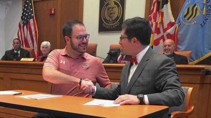 Aberdeen IronBirds general manager Matt Slatus, left, and Aberdeen Mayor Patrick McGrady shake hands after signing a one-year agreement for management of Ripken Stadium in the city council chamber on Dec. 19, 2016. A year later, future management of the facility is in limbo.