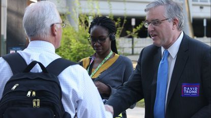 David Trone, right, owner of Total Wine & More, greets commuters at the Shady Grove Metro station during his 2016 campaign for the House. (AP Photo/Brian Witte)
