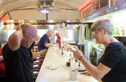 Waitress Ellen Jackson of Ellicott City jokes with Albert Stokes of Annapolis on the morning of May 21. Jackson has been working at the diner since 1994. Although she works six days a week, she says she almost always stops by on her day off to see friends.
