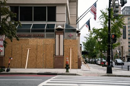 Storefronts near the White House in Washington are covered with boards on Friday, Oct. 30, 2020. Stores in cities across the U.S. are making plans for how to deal with potential civil unrest stemming from the election on Tuesday.