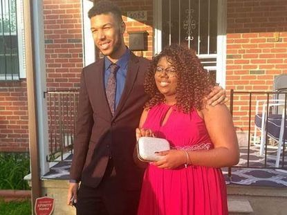 Pedro Chesley, 20, and Diamond Davis, 21, stand together and pose for a photo as they couple gets ready for a high school prom.