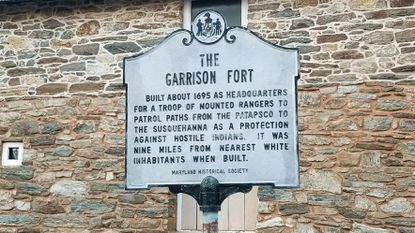 "A historical marker at Fort Garrison in Baltimore County. The sign has since been removed over its use of the words ""hostile Indians."""