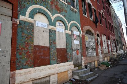 Cab Calloway's former home is boarded up like much of the 2200 block of Druid Hill Avenue in Baltimore.