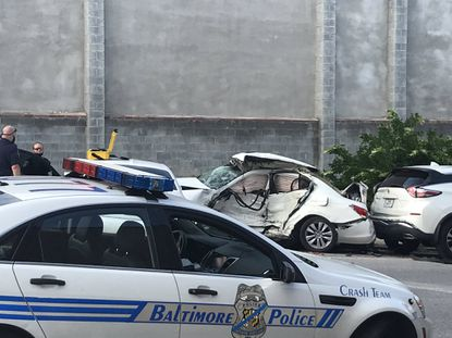 Baltimore Police said a woman died in East Baltimore on Thursday after a car struck her vehicle. She was an innocent bystander in the incident. Photo by McKenna Oxenden