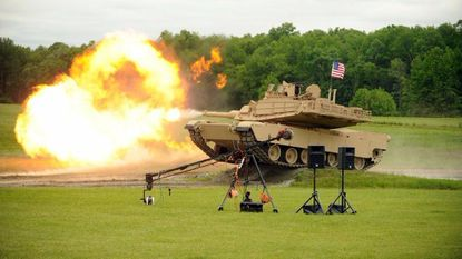 Flames spew from the cannon on an M1A2 Abrams main battle tank during a live fire demonstration on Aberdeen Proving Ground on Saturday, May 20. The event was part of a celebration for the 100th Anniversary of APG and the U.S. Army Aberdeen Test Center.