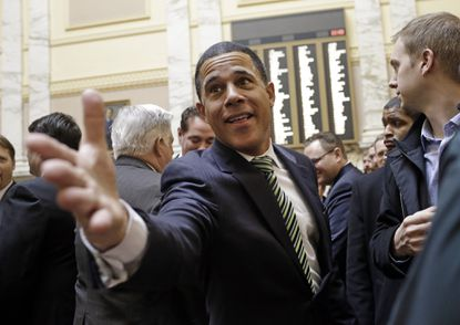 Outgoing Maryland Lt. Gov. Anthony Brown greets members of the House of Delegates in Annapolis, Md., Jan. 14, 2015, the first day of the 2015 legislative session.