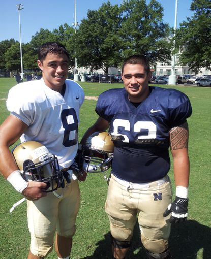 Navy's Wave Ryder, left, and his brother Blaze Ryder pose for a photo after practice earlier this season. They're one of five sets of brothers on the Midshipmen roster.