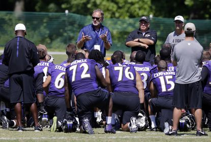 Former Ravens coach Brian Billick, center, addresses the team after a training camp practice.