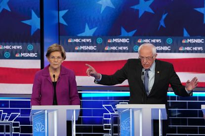Sen. Bernie Sanders speaks during the Democratic presidential debate at the Paris Theater in Las Vegas earlier this month. At left is Sen. Elizabeth Warren. Some say both candidates' ideas for making the country better are expensive, but if we don't pay for America's problems now the cost will be greater in the future.