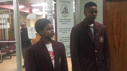 Sixth-grader Calvin Robinson (left) and eighth-grader Joshua Jones speak in support of their school, Banneker Blake Academy.