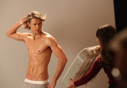 "Rachel (Lea Michele, R) helps Sam (Chord Overstreet, L) with a photo shoot in the 'Movin' Out' episode of ""Glee."""
